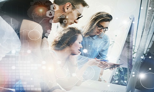 Coworkers Team Working Office Studio Startup.Businessman Using Modern Tablet,Desktop Monitor Wood Table.Bank Managers Market Researching Process.World Wide HiTech Diagram Interface Screen.Blurred.