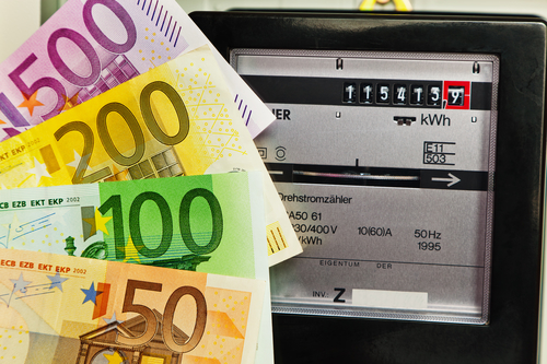 An electricity meter in a household. supply of electricity and energy. with euro notes.